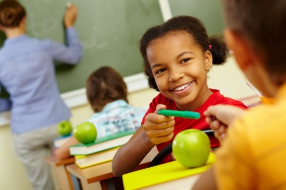 happy-student-sharing-her-green-pencil_1098-3913