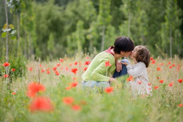 woman-kissing-her-lovely-daughter-outdoors_1139-358.jpg