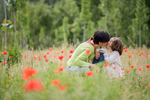 woman-kissing-her-lovely-daughter-outdoors_1139-358.jpg