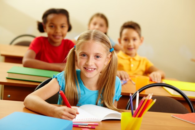 cheerful-student-painting-with-classmates-background_1098-3719