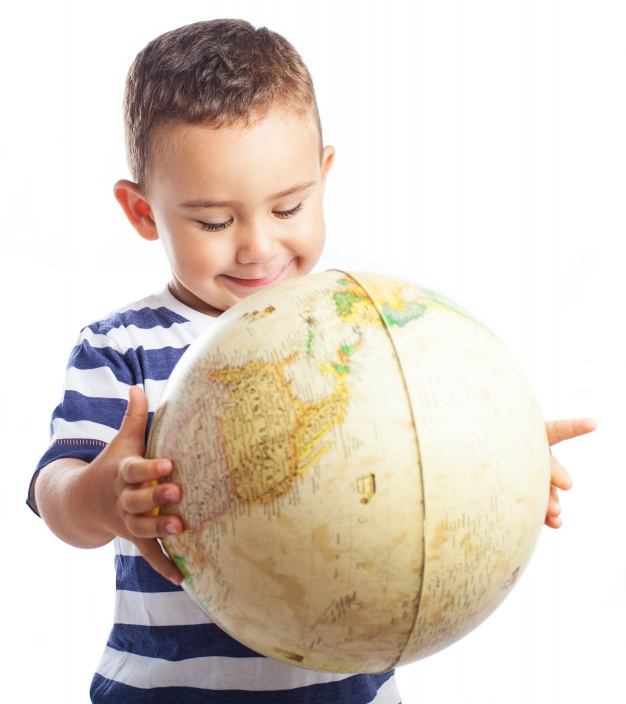 child-smiling-with-a-globe_1187-2637