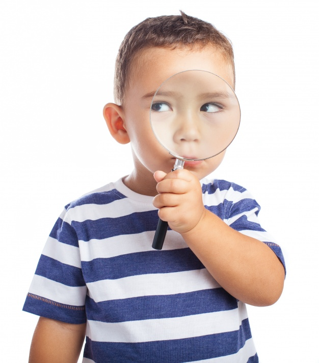 little-boy-with-a-magnifying-glass_1187-2677