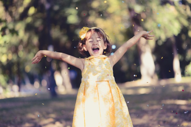 little-girl-throwing-confetti-in-the-air_1139-231