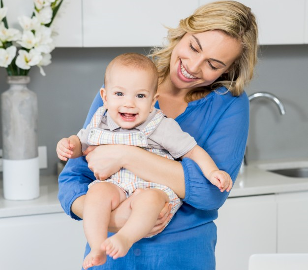 mother-holding-her-baby-boy-in-kitchen_1170-400.png