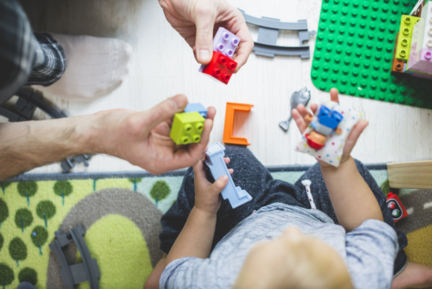 father-and-son-playing-with-colorful-pieces_23-2147615859.jpg
