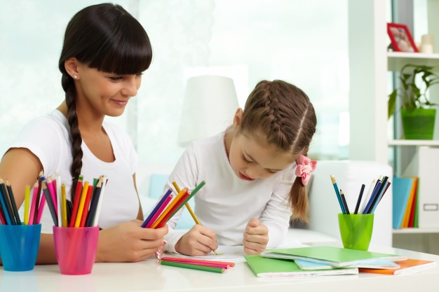 mother-helping-her-daughter-to-draw_1098-2439